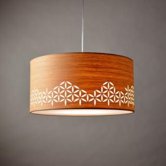 medinis pakabinamas šviestuvas su saulės ornamentu